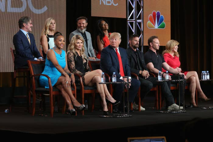Vivica sits onstage with Donald Trump and the other contestants