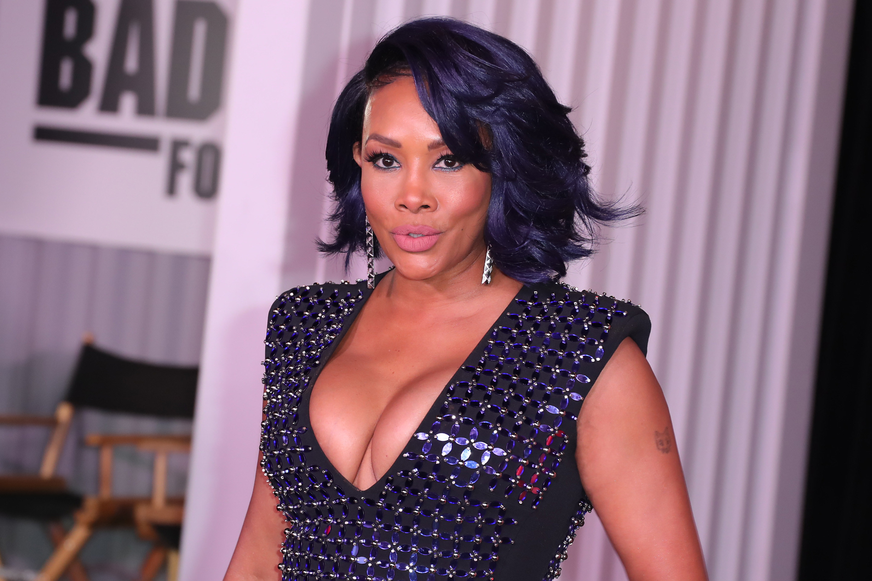 Vivica wears a black dressed with a sequined pattern