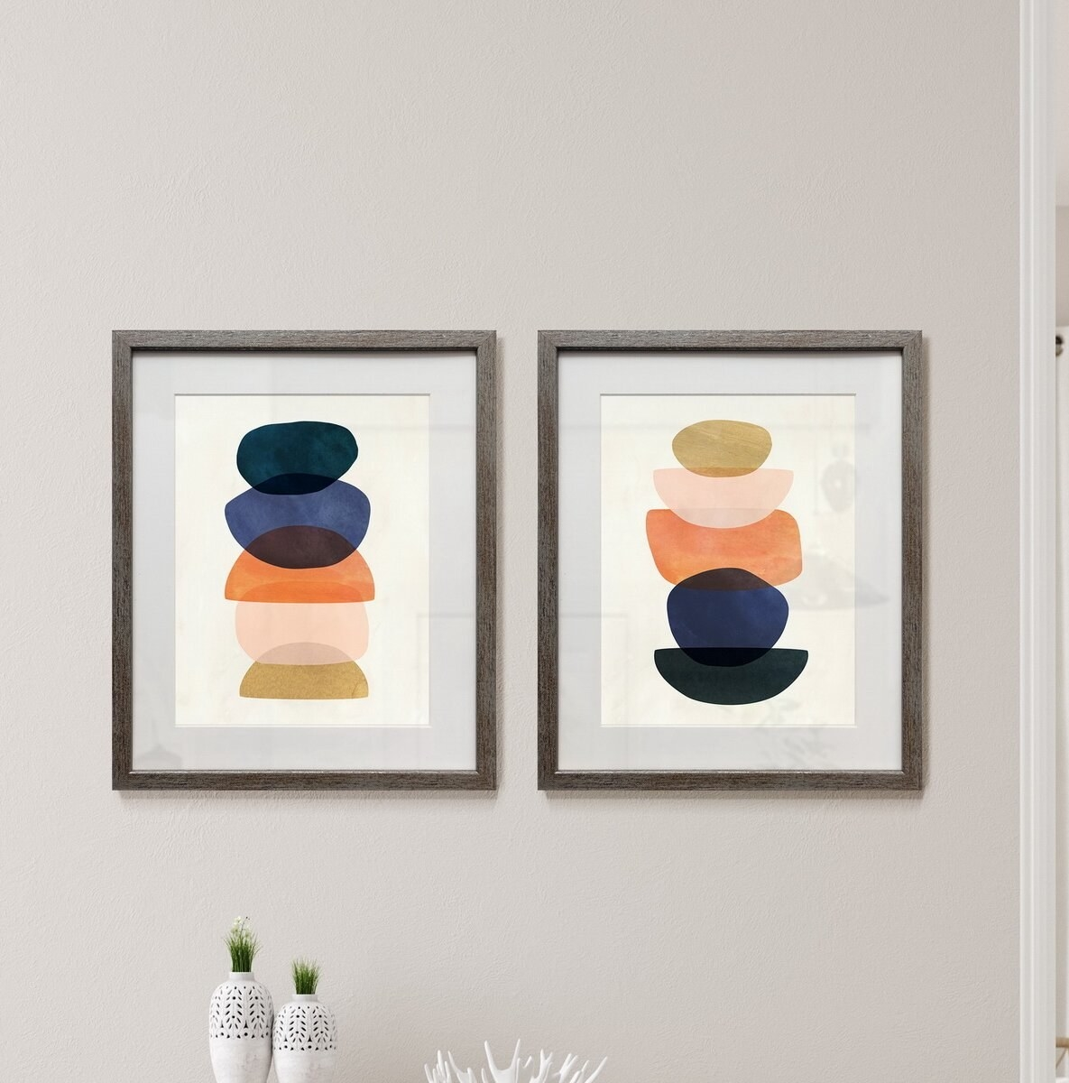Set of abstract paintings over table decor