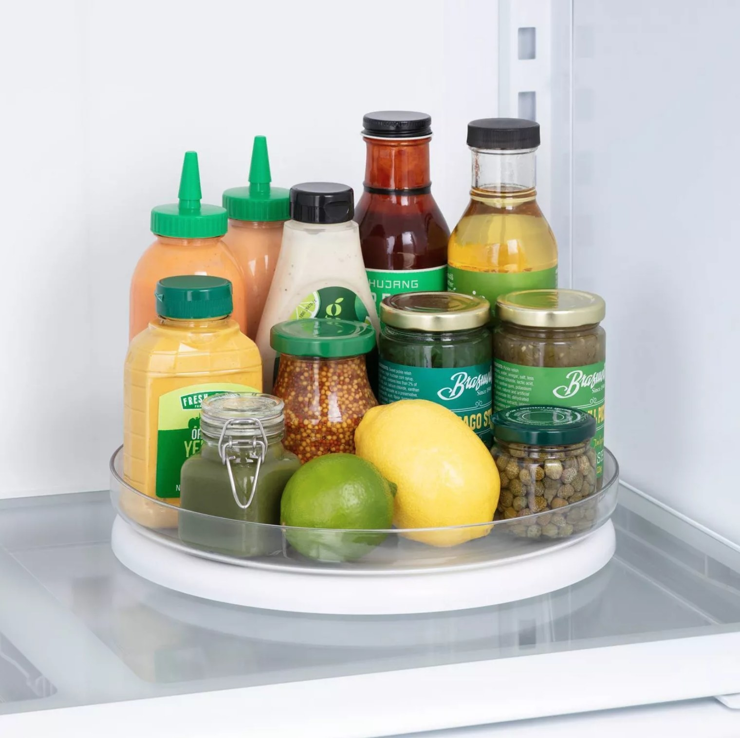the turntable with condiments in the fridge