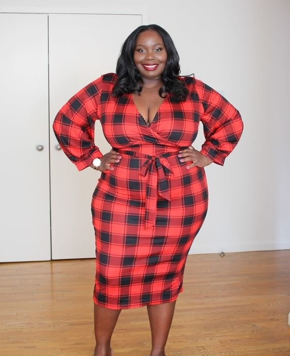 Reviewer wearing the dress in red plaid design