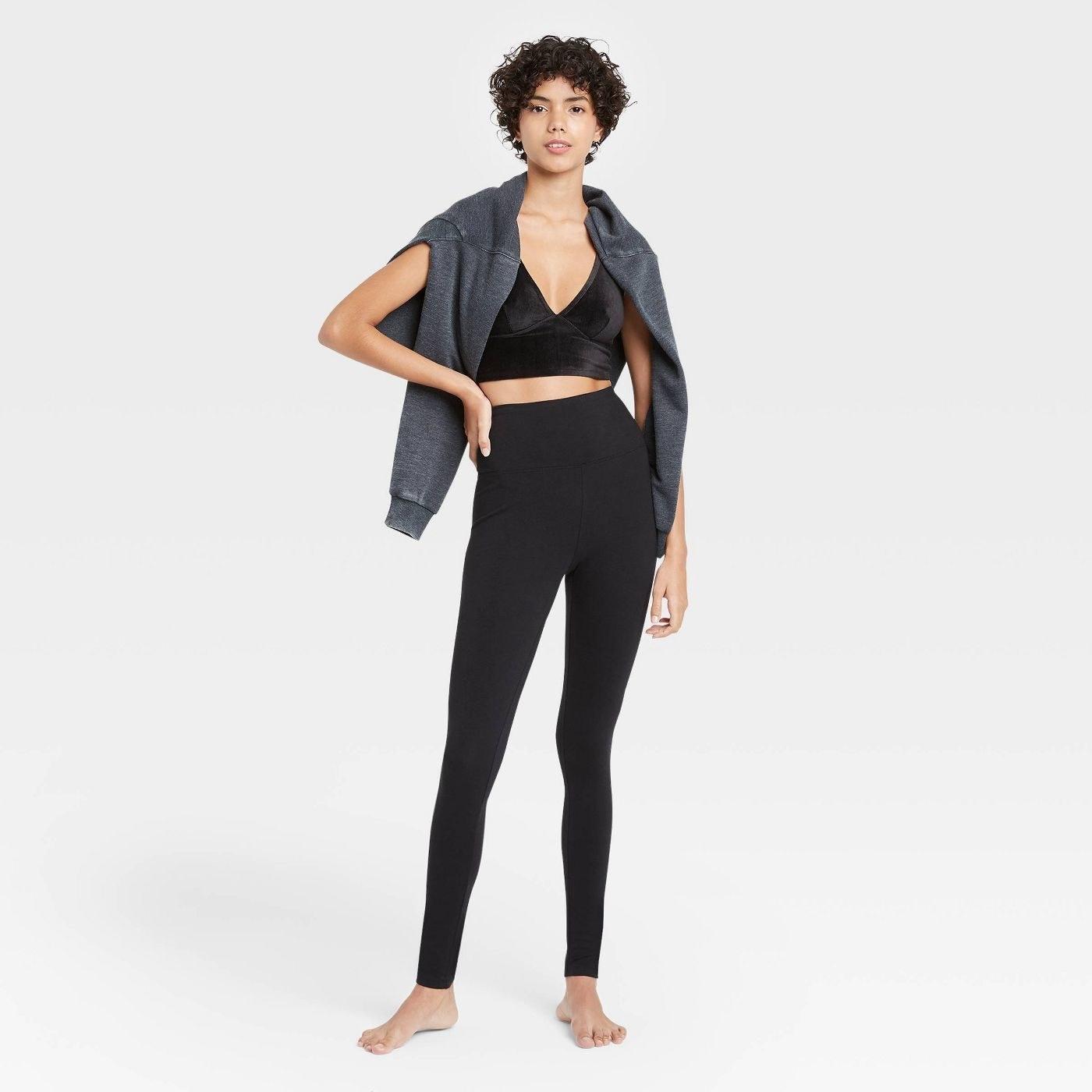 model in the black leggings