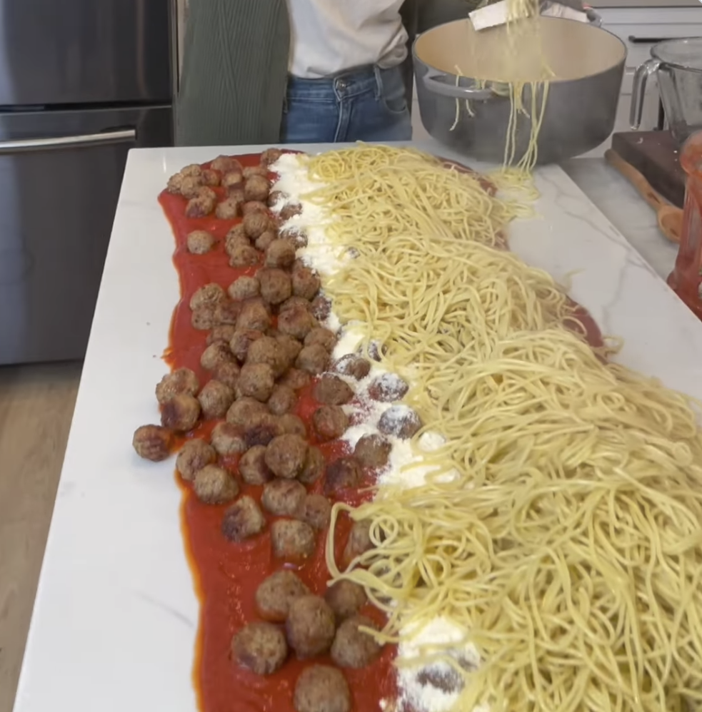 A counter covered in spaghetti and meatballs