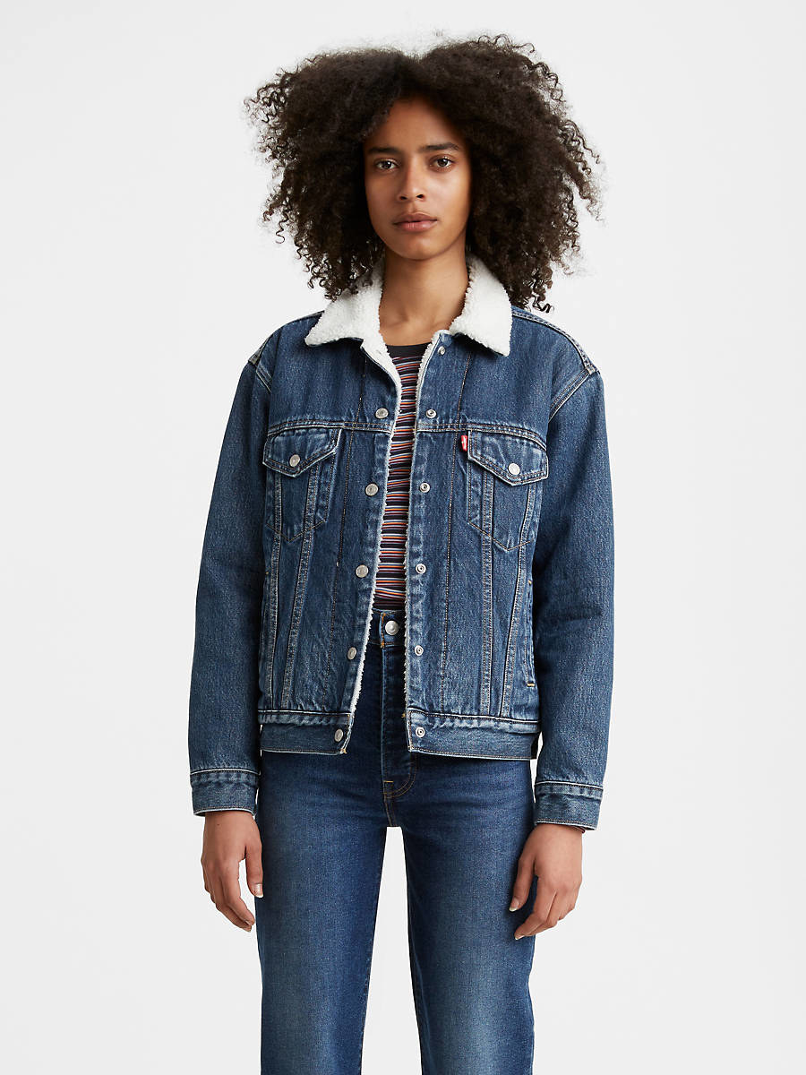 model wearing the medium wash jacket, which hits at the hip