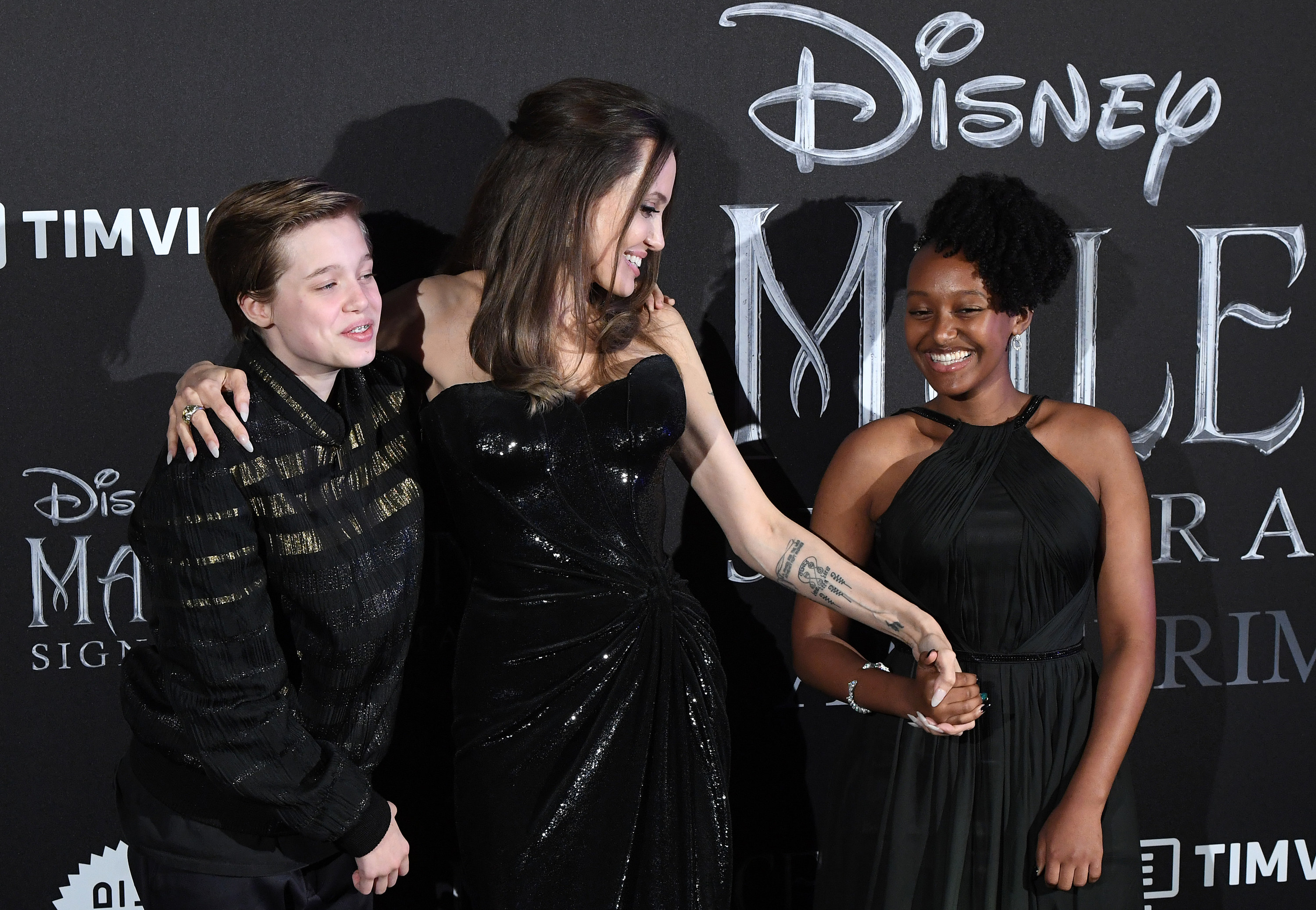 Angelina laughing with two of her kids Shiloh and Zahara