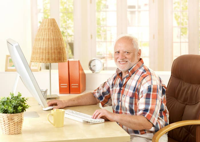 An old man using the computer