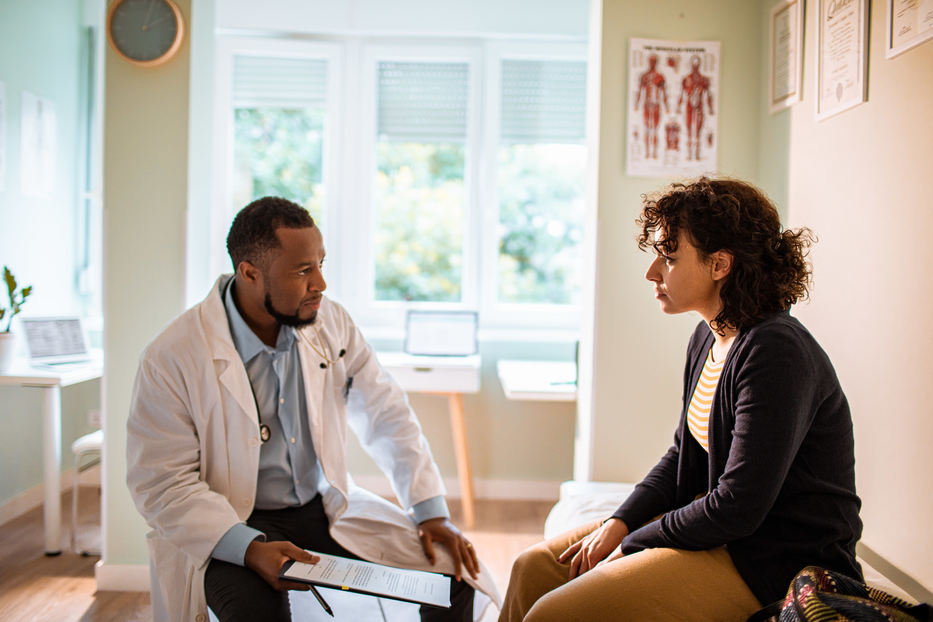 Young woman talking to her doctor during an appointment