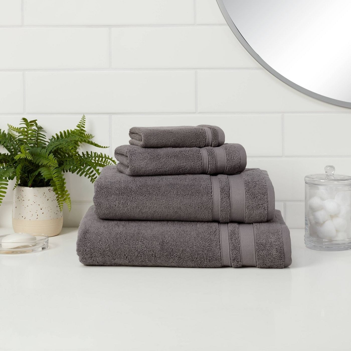 A set of grey bath towels in a home