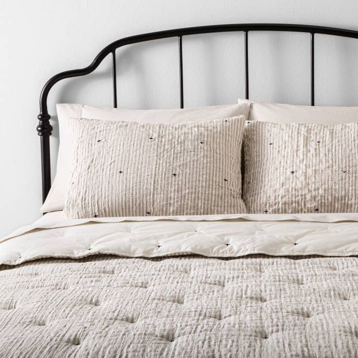 A neutral comforter set in a home