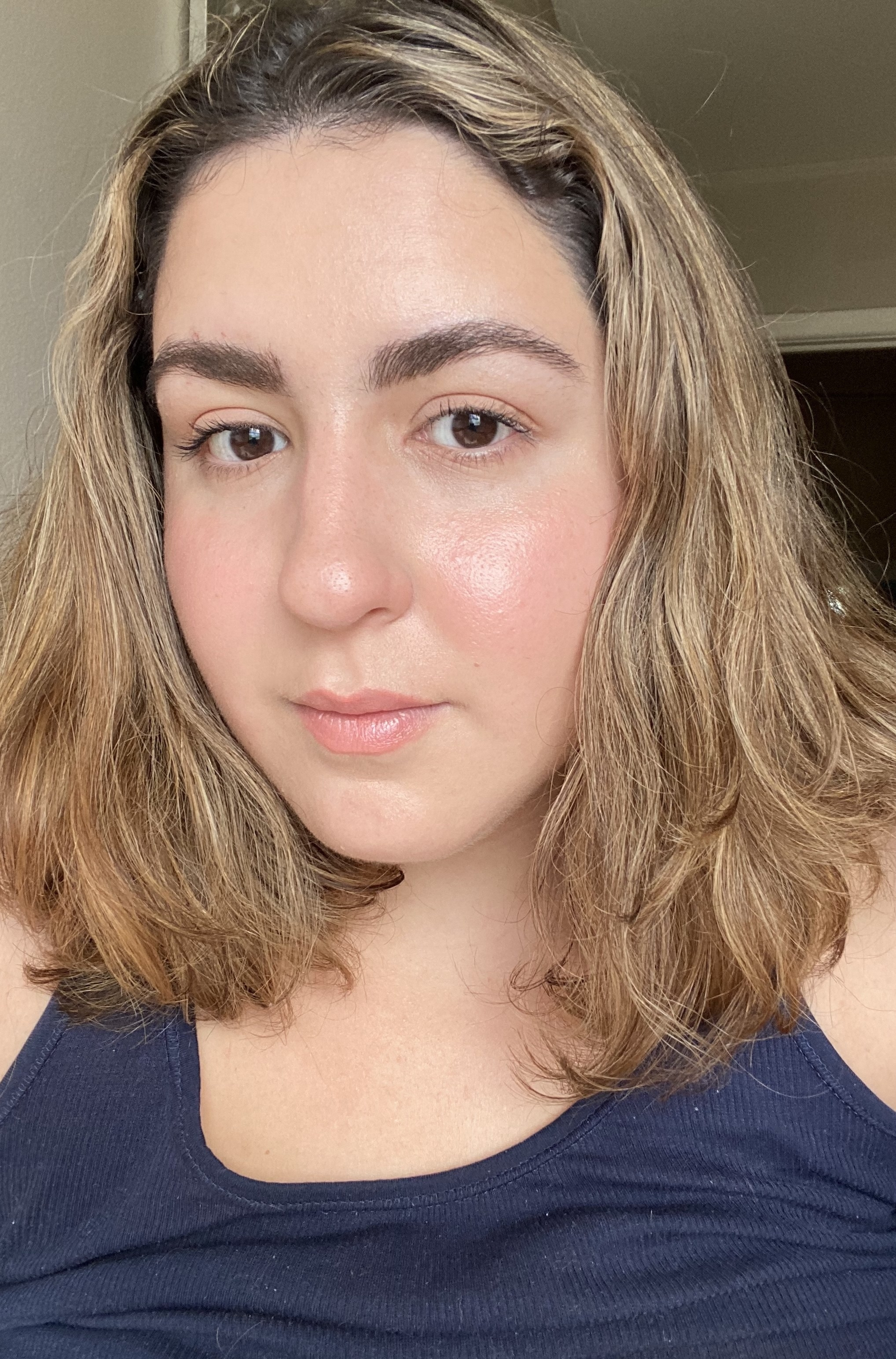 the writer's wavy hair looking nice and smooth after an Olaplex treatment