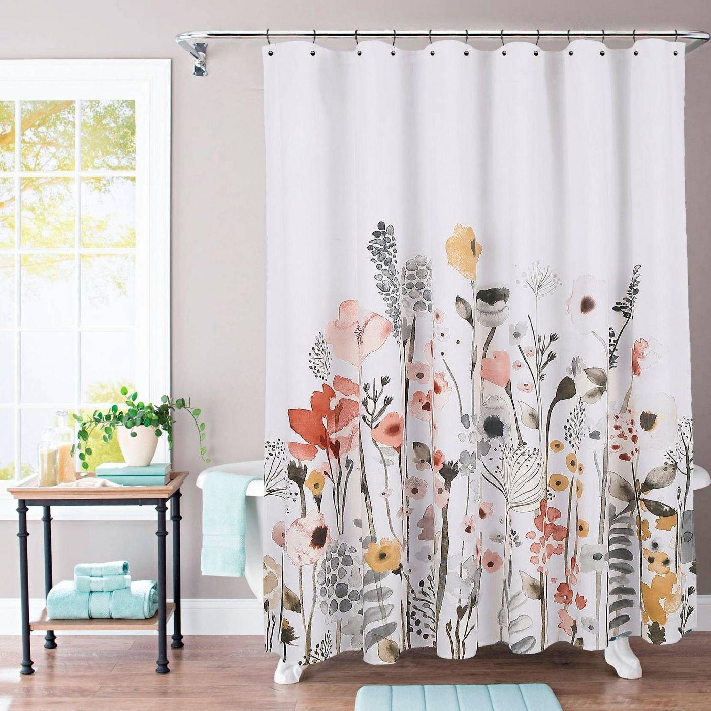 A multi-colored flower shower curtain in a home