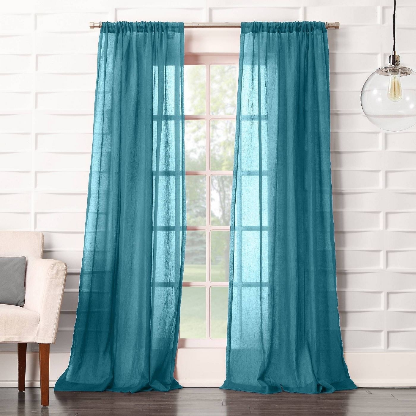 Blue sheer curtains in a home