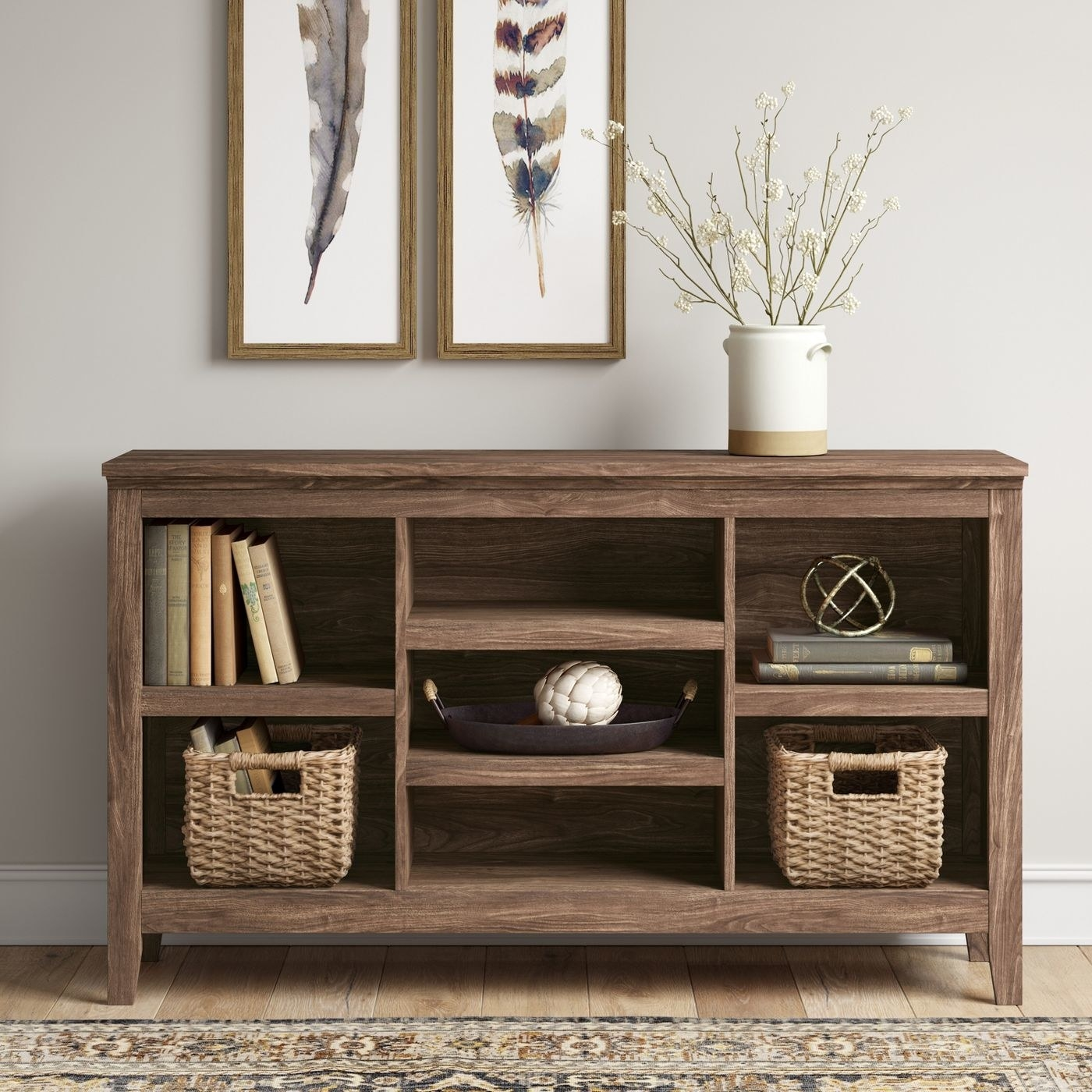 A brown horizontal bookshelf/storage unit in a home