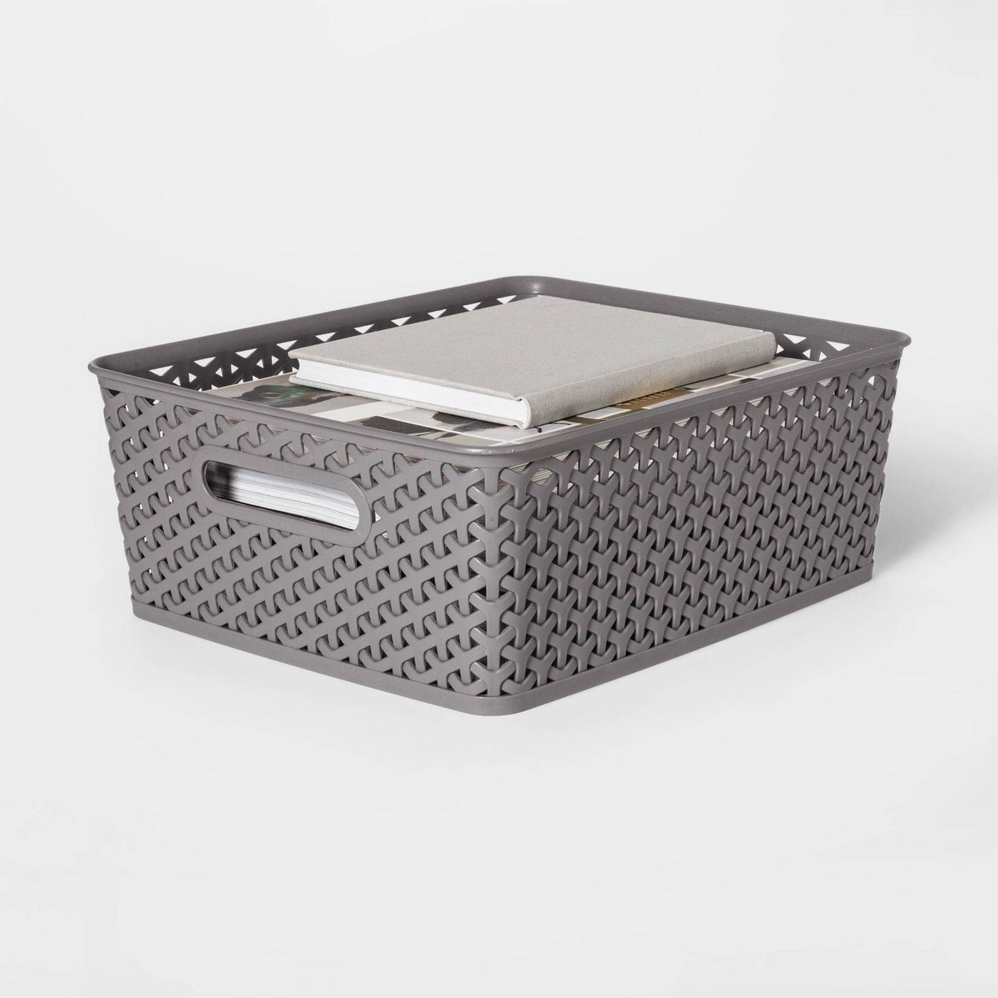 A grey storage basket
