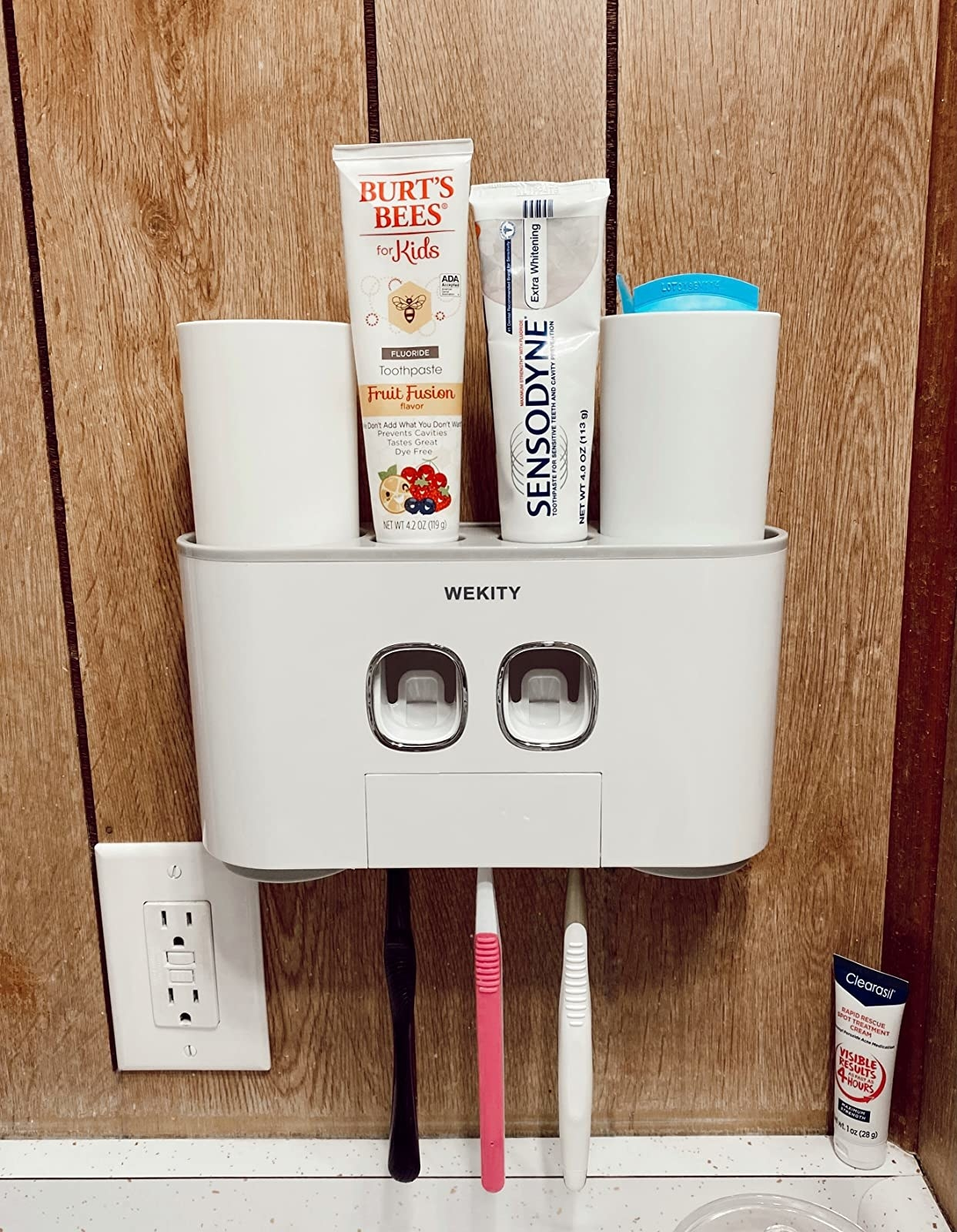 the white wall mounted toothbrush holder