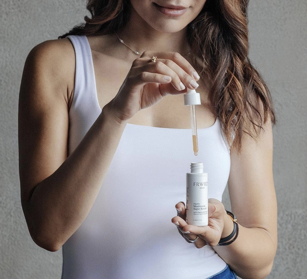 Model is holding the serum