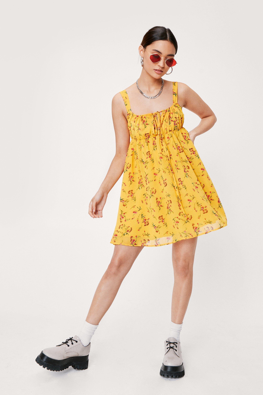 model in mini tank dress with loose skirt
