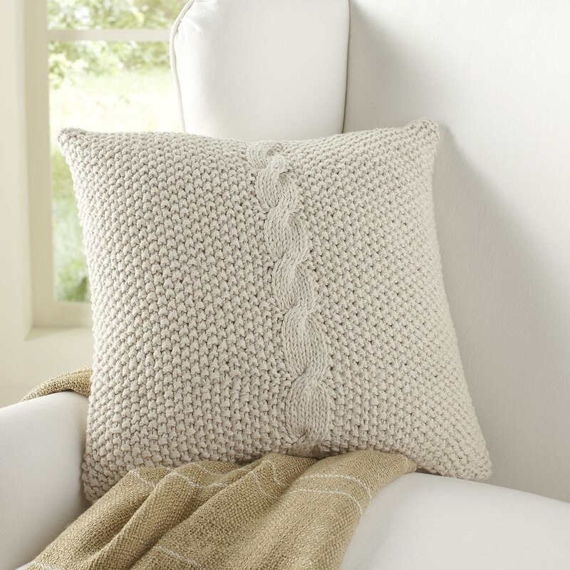 Classic throw pillow on cream couch