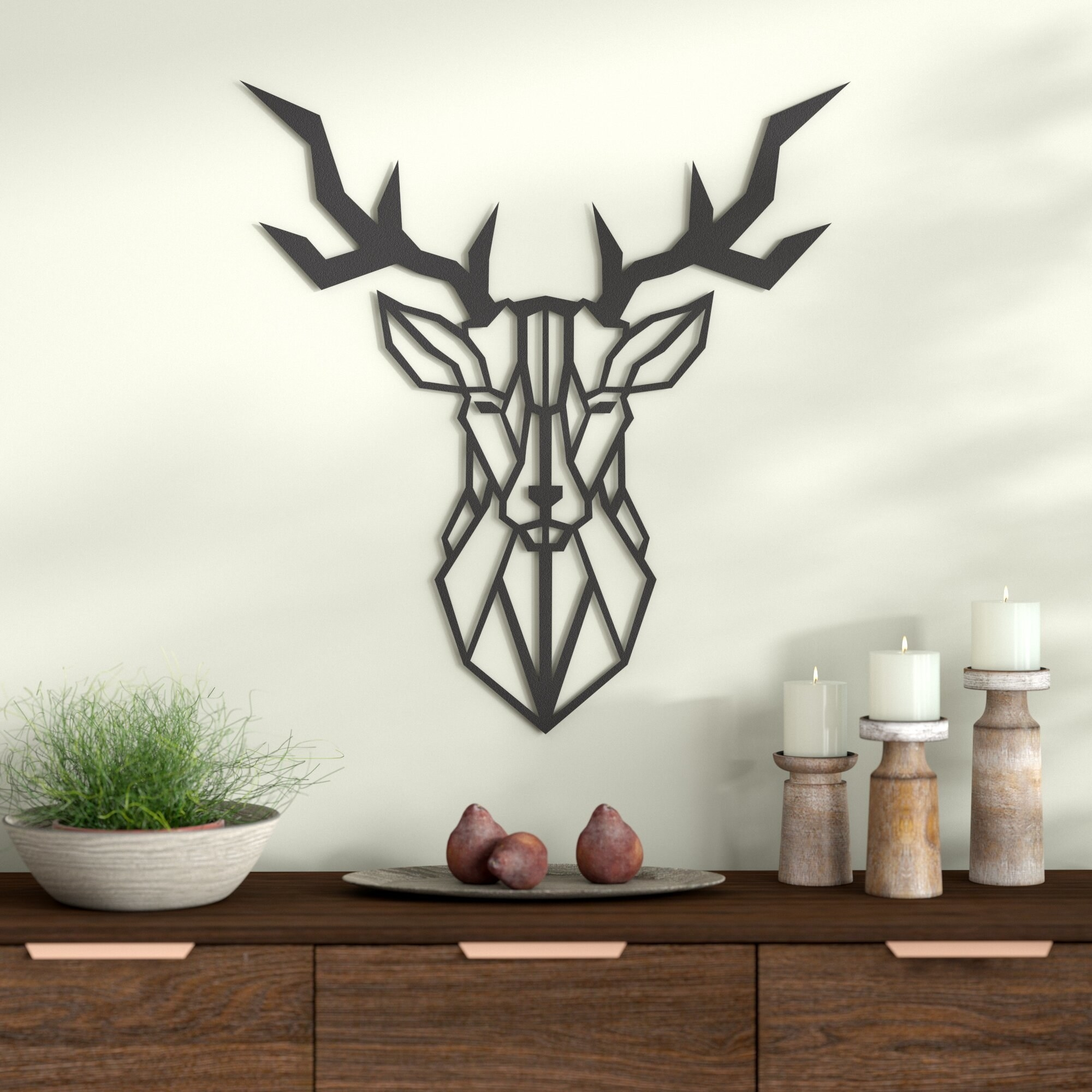 black deer decor mounted on a wall