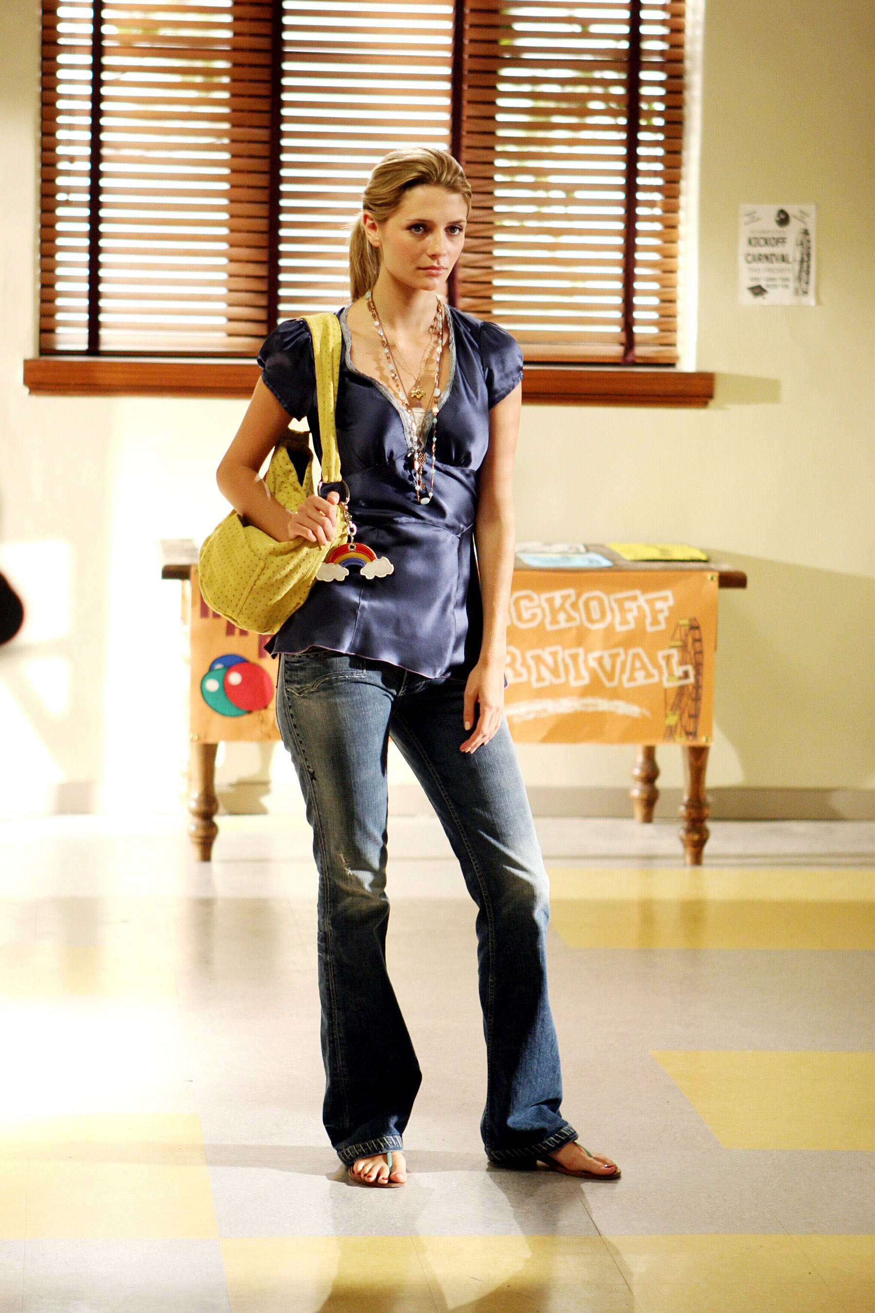 Boot cut jeans with sandals, a puff short-sleeve silk V-neck wrap top, and a bunch of chunky necklaces