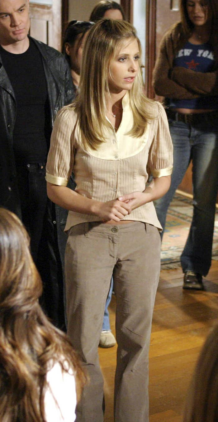 Short, slightly puff sleeve, tuxedo ruched-front button-up collar top with loose, low-waist khaki pants