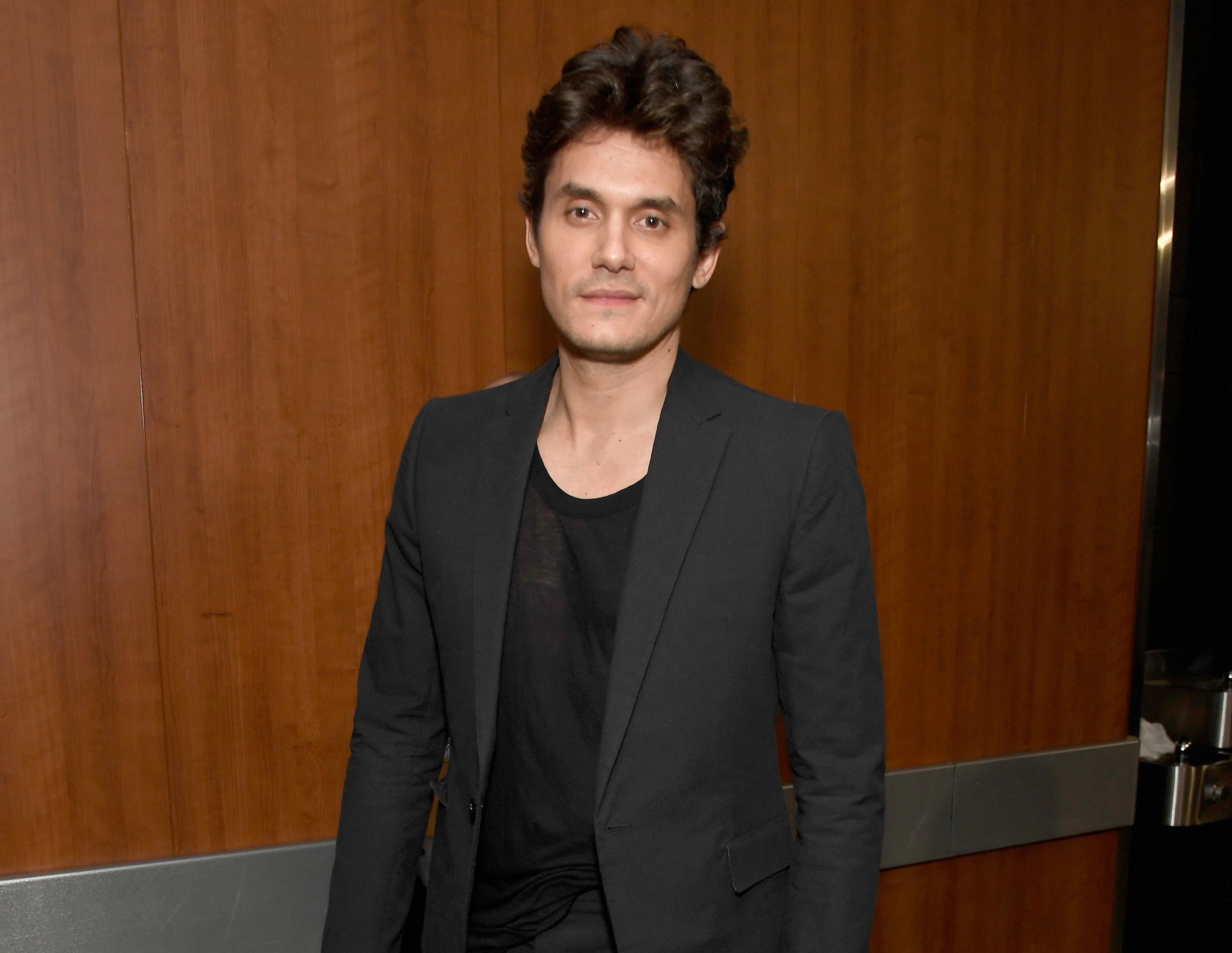 John wears a suit jacket to an event