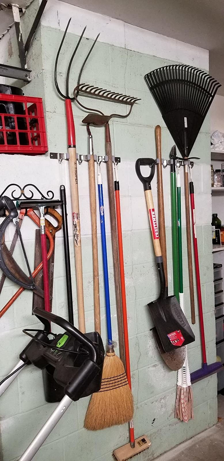reviewer image of the hooks holding garden tools