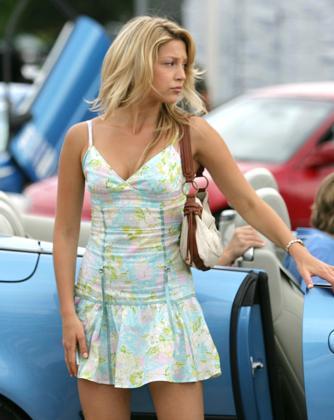 Ruched tight-waist dress with low-waist flare short skirt, a pastel floral pattern, and a triangle bikini-like top with spaghetti straps