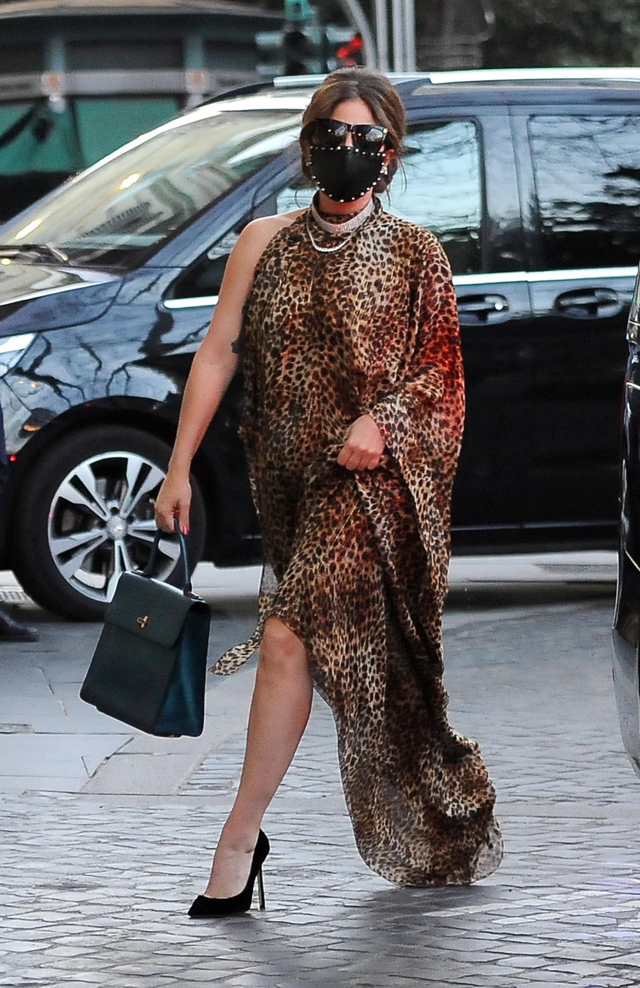 Gaga in a one shoulder caftan dress and heels