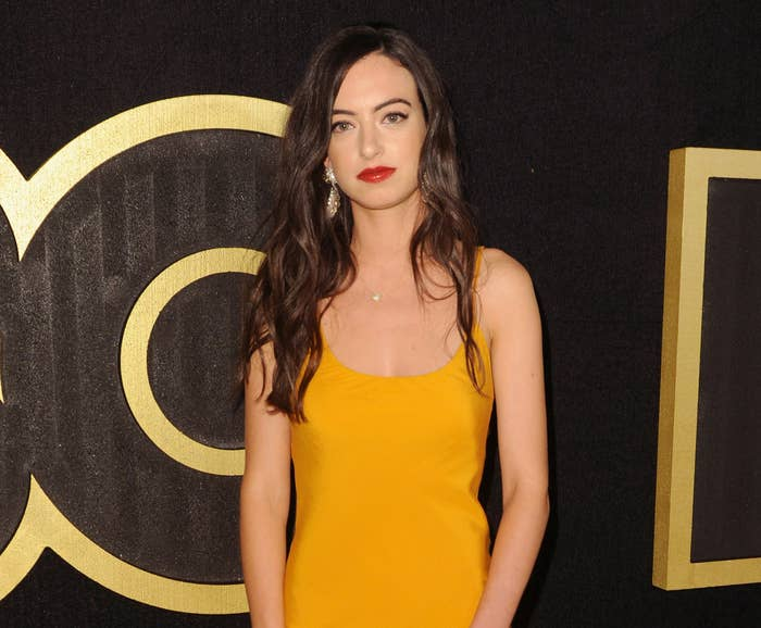 Cazzie wears a yellow dress to an event