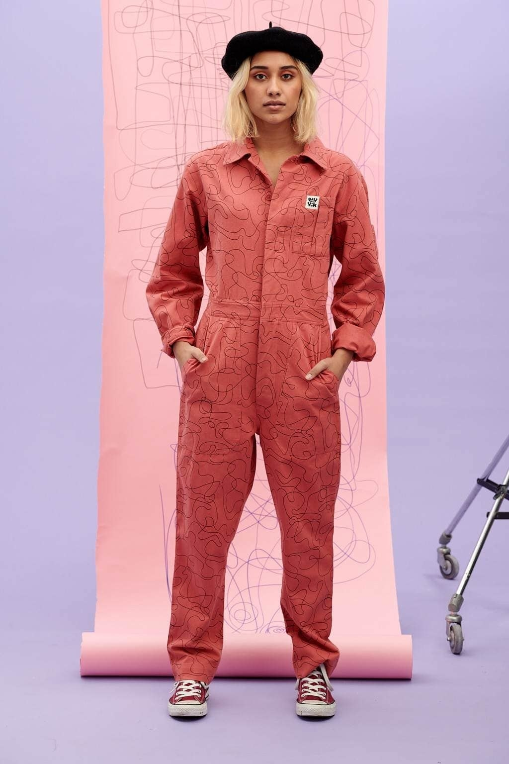 a model wearing the carmen boilersuit in the peyton print