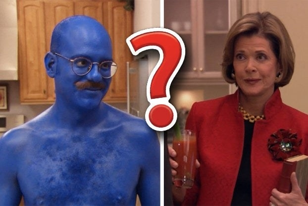 Guy covered in blue paint and woman looking judgey