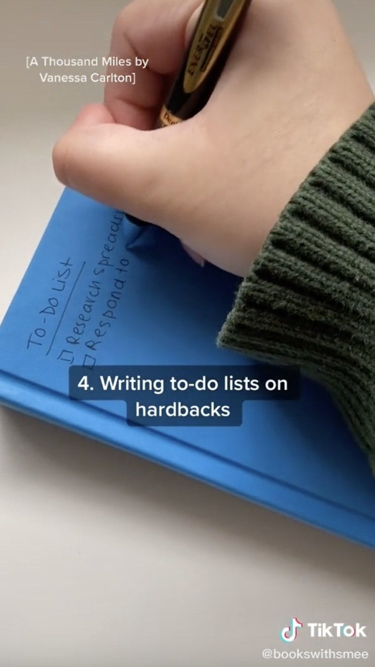 TikTok of making to-do list on blue book