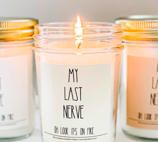Lit candle that says My Last Nerve Oh Look It's On Fire