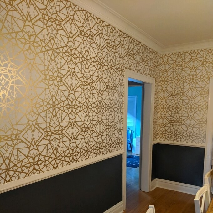 the gold and white wallpaper in a reviewer's dining room