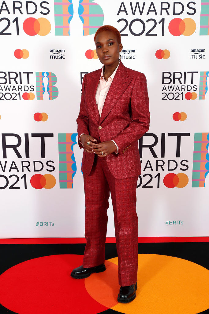 Arlo Parks rocks a pantsuit that matches her hair color at The BRIT Awards 2021
