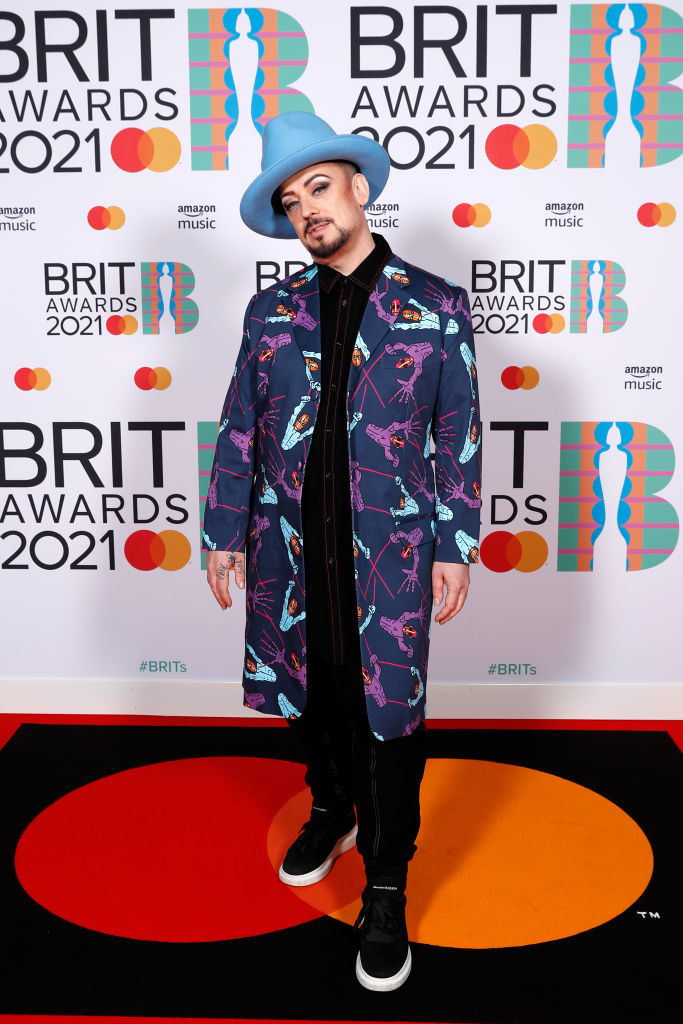 Boy George poses in the media room