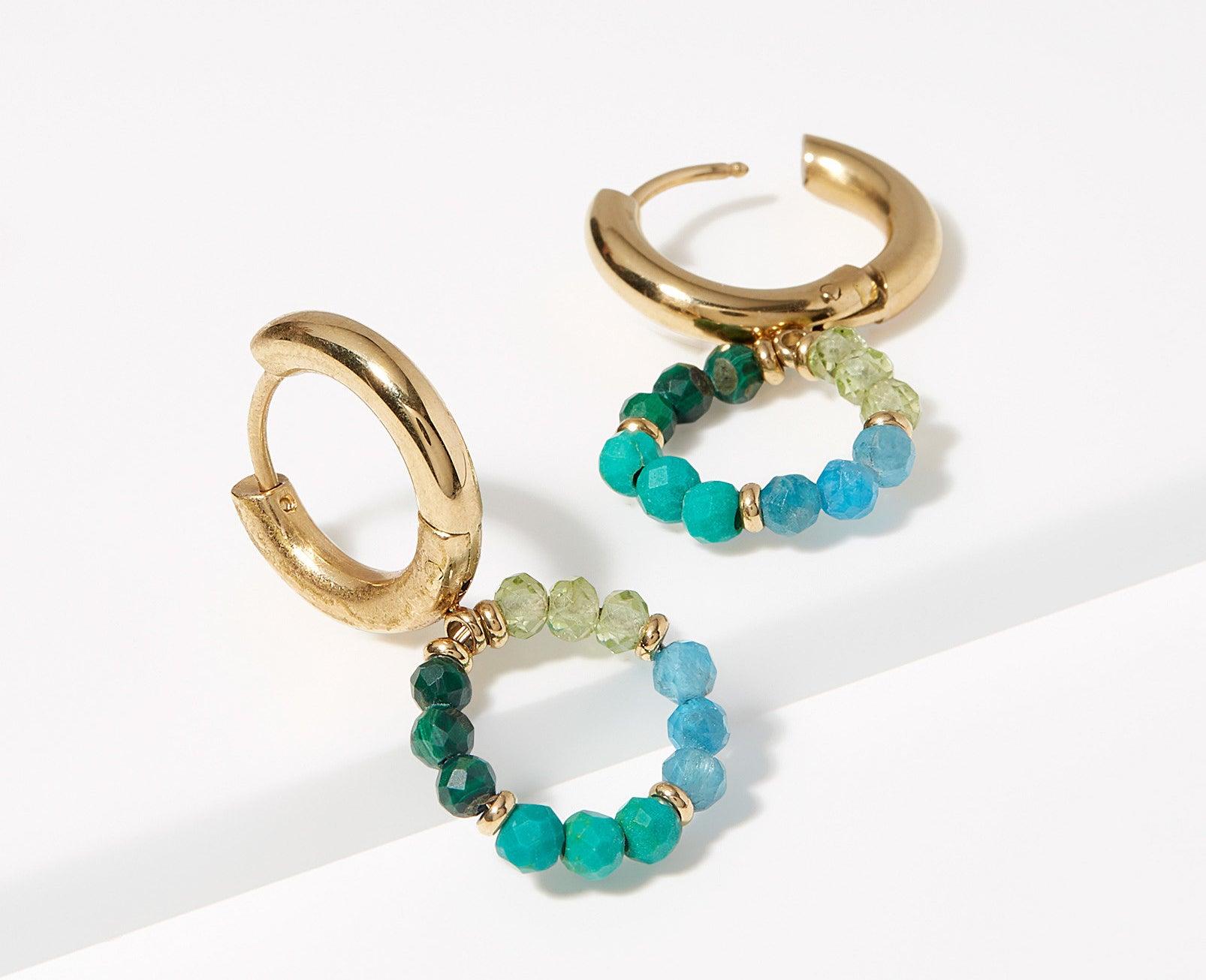 A pair of small huggie hoop earrings