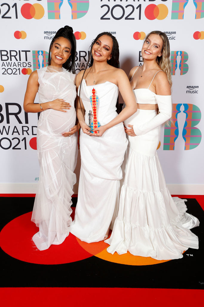 Leigh-Anne Pinnock, Jade Thirlwall, and Perrie Edwards of Little Mix pose with their British Group award in the media room