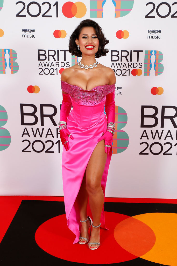 Raye attends The BRIT Awards 2021 in a Marilyn Monroe-esque off-shoulder gown with matching gloves