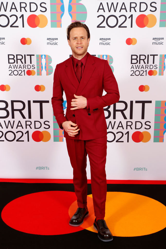 Olly Murs rocks a monochrome suit, tie, and shirt at The BRIT Awards 2021