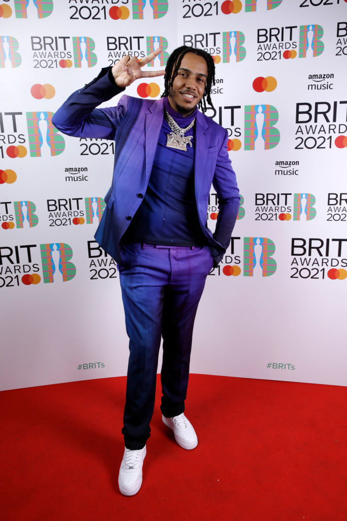 AJ Tracey poses in the media room during The BRIT Awards 2021