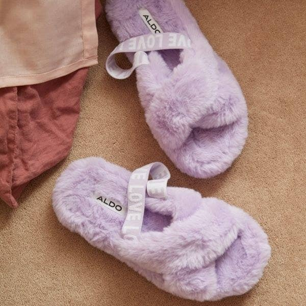 A pair of furry slippers on a carpet