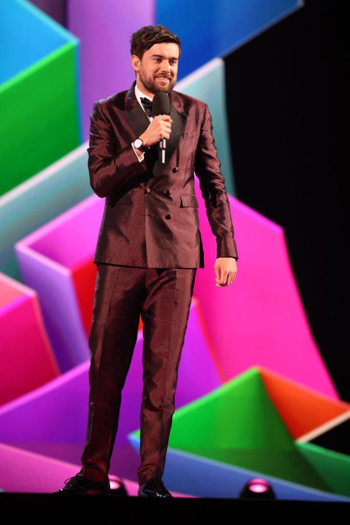 Jack Whitehall speaks on stage during The BRIT Awards 2021