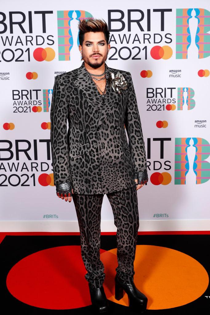 Adam Lambert poses in the media room