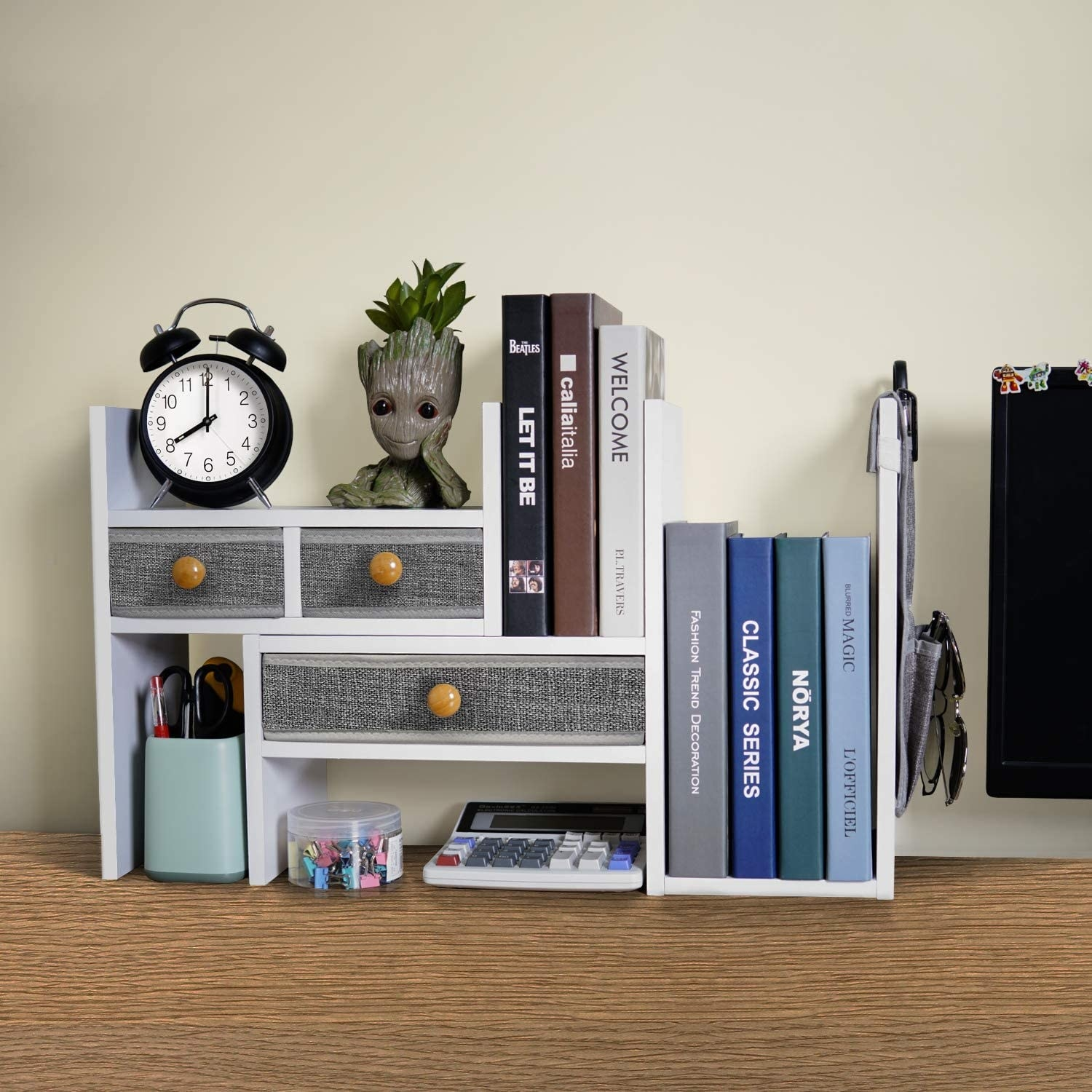 the white desktop organizer with grey linen pull-out drawers