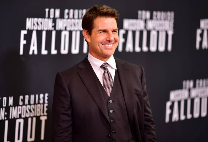 Tom Cruise smiles at the premiere of a Mission Impossible movie