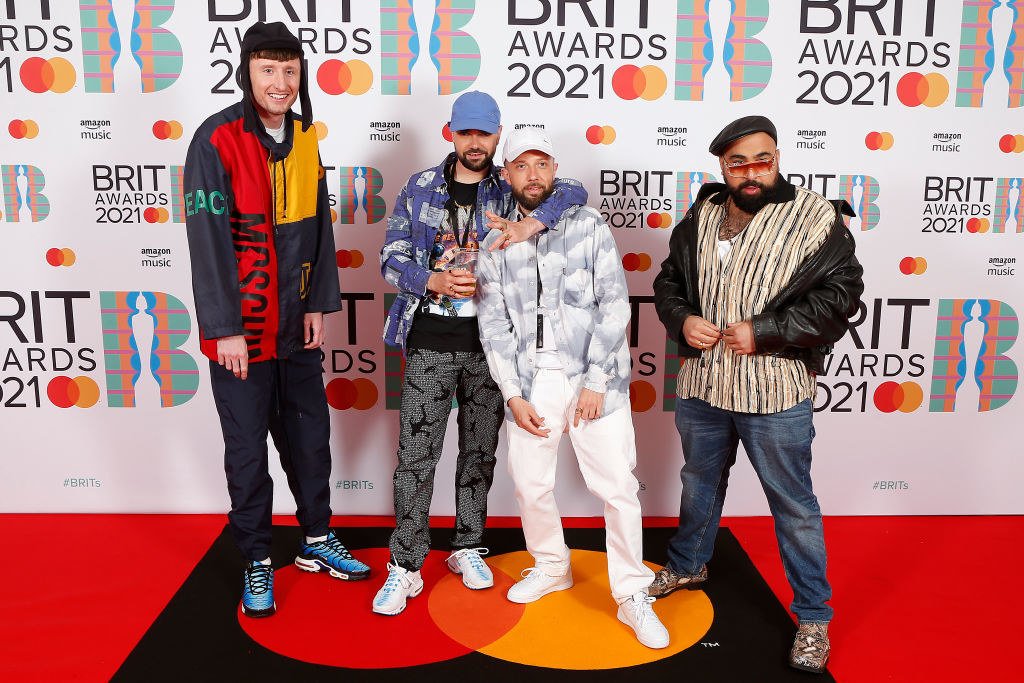 (L-R) Steve Stamp, Allan Mustafa, Hugo Chegwin, and Asim Chaudhry aka Chabuddy G of Kurupt FM attend The BRIT Awards 2021
