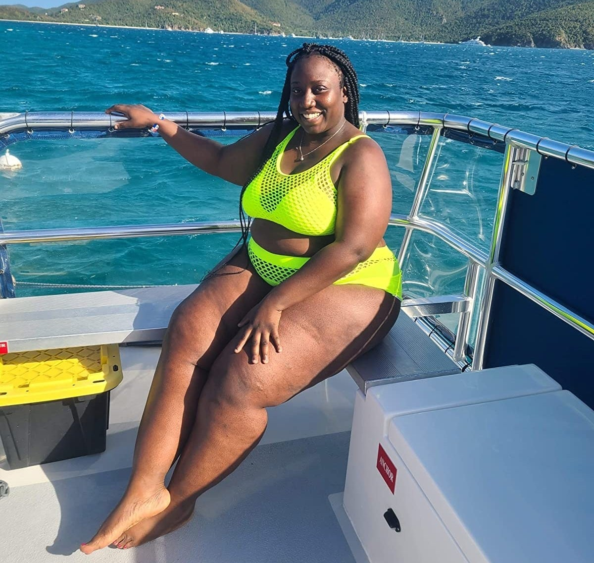 Reviewer wearing the neon green bikini set with fishnet overlay