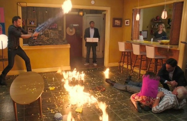 Troy walks into his apartment with pizza to find fire and chaos